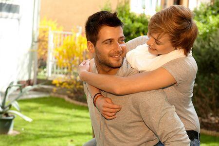 Happy loving couple having fun outdoors. Hugging, smiling. photo