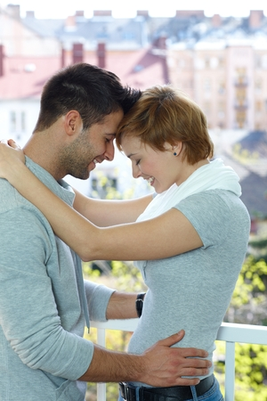 gingerish: Happy young loving couple embracing heads together. Stock Photo