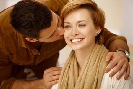 be kissed: Closeup portrait of young loving couple. Man kissing woman.