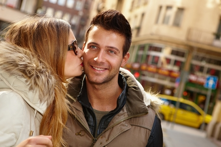 be kissed: Closeup photo of kissing couple in the city, smiling happy. Stock Photo