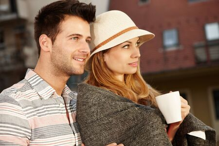 Closeup portrait of young loving couple. Side view. photo