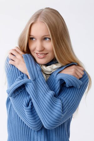 folding arms: Young woman smiling, folding arms around, freezing.