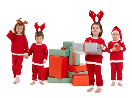 Happy small children in red christmas dress with wrapped box of present. Standing looking at camera, smiling, isolated on white. photo
