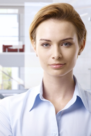 gingerish: Portrait of young casual attractive caucasian businesswoman, looking at camera.