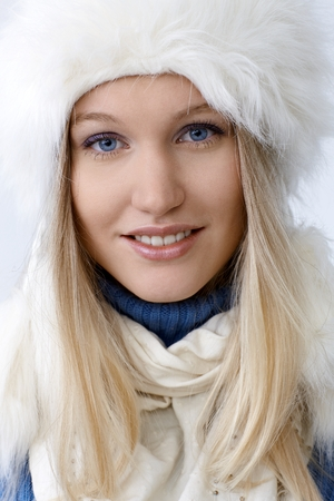 Closeup portrait of attractive young blonde woman smiling, looking at camera. photo