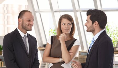 bristly: Confident caucasian business team meeting at office. Wearing suit, smiling, bristly.