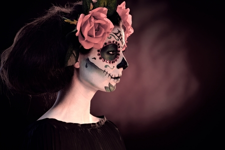 mexican black: Woman in Halloween makeup - mexican Santa Muerte mask. Stock Photo