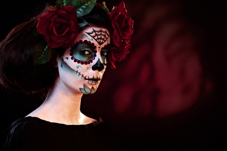 Woman in Halloween makeup - mexican Santa Muerte mask. Stock Photo
