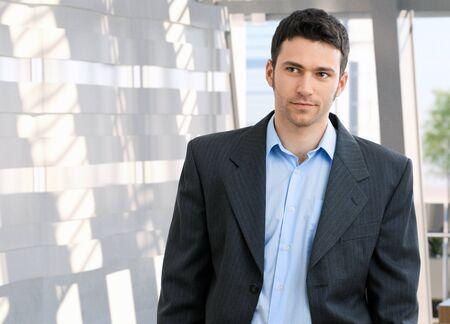 white color worker: Portrait of young caucasian office worker. Suit no tie, copyspace. Stock Photo