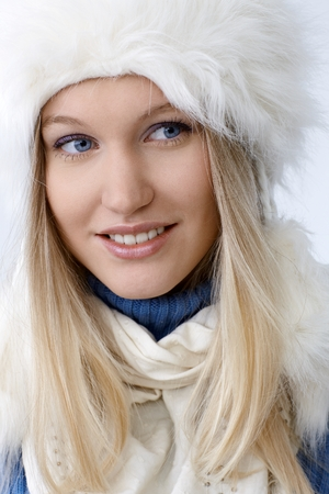 Closeup portrait of smiling young woman at wintertime. photo