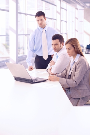 Young businesspeople working together at meetingroom. Stock Photo