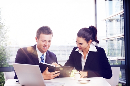 Business partners having meeting at office, smiling, busy by work. Stock Photo