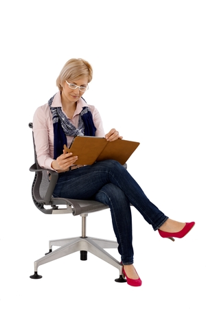 swivel: Businesswoman using tablet computer, sitting in swivel chair.