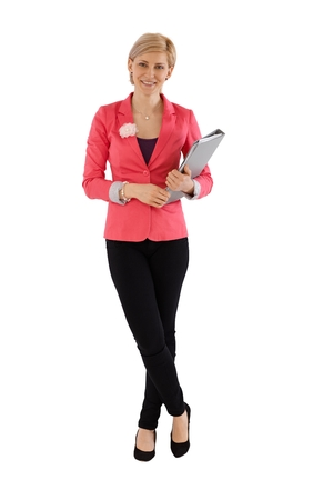 image size: Confident businesswoman standing over white background, holding folder, smiling. Stock Photo