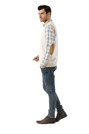 full size: Side view of young man over white background. Full size. Stock Photo
