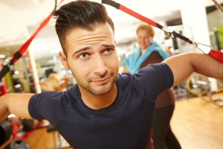 stockphoto: Determined young man training in gym.