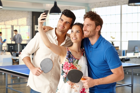 companionship: Young companionship making a selfie in  hall. Stock Photo