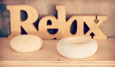 Home spa interior with relax text and candle-light. Stock Photo