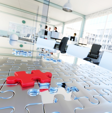 Conceptional image of providing a business solution. Pieces of puzzle on meeting table modern office in background.