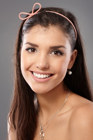 20s  closeup: Closeup portrait of natural beauty young woman smiling, looking at camera. Stock Photo