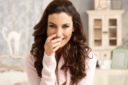 shy woman: Portrait of attractive young woman with a shy smile.