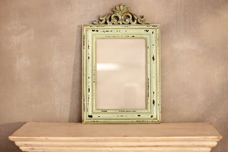 bad color: Retro style frame in front of painted wall.
