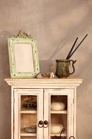 bad color: Retro home interior with show-case, frame and paintbrush. Stock Photo