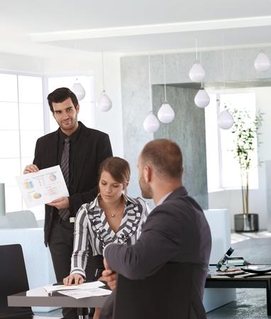 co work: Elegant businesspeople working together, having meeting.