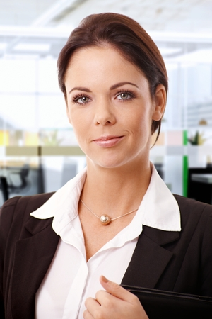stockphoto: Closeup portrait of attractive young businesswoman, looking at camera.
