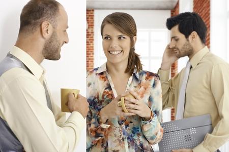 coffeebreak: Young people having coffee-break, talking, smiling happy.