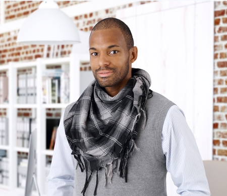 place of work: Portrait of stylish young black businessman, looking at camera.