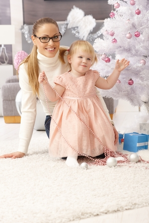 Mother and little daughter celebrating christmas. Stock Photo