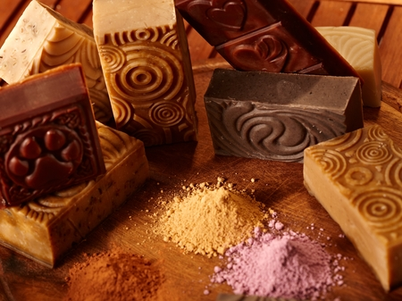 hand made: Close-up photo of hand made natural soap bars and ingredients.