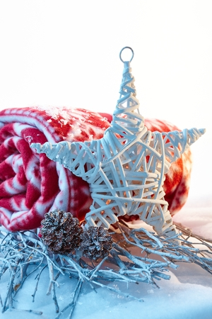 pineal: Natural christmas decoration with star and blanket. Stock Photo