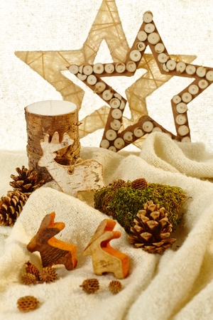 pineal: Natural christmas decoration with stars and autumn fruits.