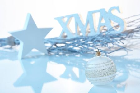 stockphoto: Pure white christmas decoration with ornaments and letters xmas.