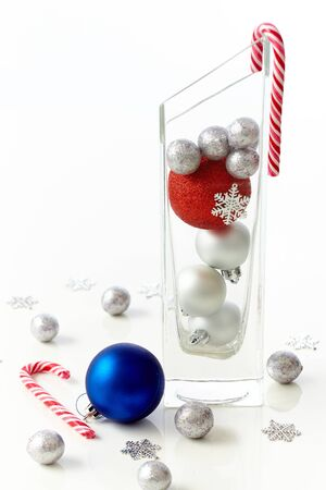 stilllife: Christmas still-life with ornaments and candy cane.