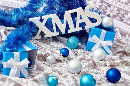 stockphoto: Christmas still-life in blue with ornaments and letters xmas. Stock Photo