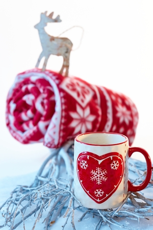 stockphoto: Christmas still-life in red and white with mug and reindeer.
