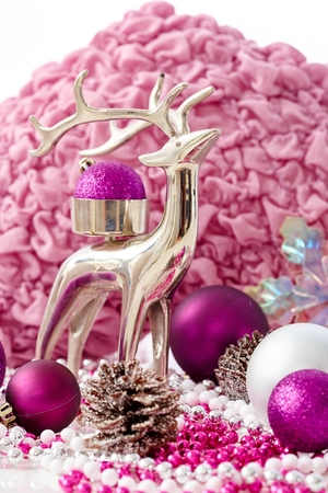 pineal: Christmas decoration in rose and violet colour with reindeer and ornaments.