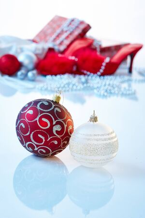 no heels: Christmas mood with ornaments and presents in red.