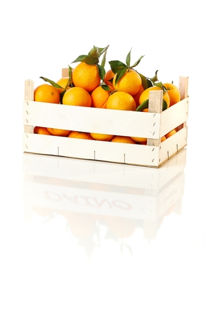stockphoto: Fresh oranges stored in a wooden box. Stock Photo