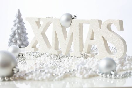 stilllife: Pure white christmas still-life with ornaments. Stock Photo