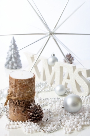 pineal: Pure christmas decoration with candle, pineal and letters xmas.