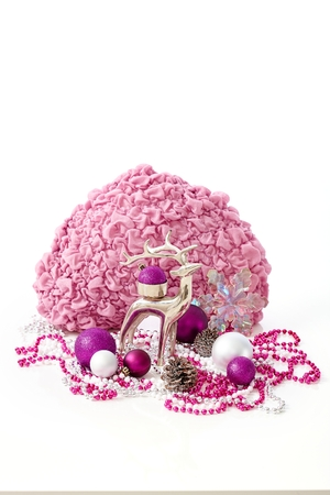 stilllife: Christmas still-life with reindeer, ornaments in rose and violet colour.