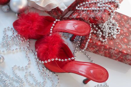 no heels: Christmas still-life with red high heel slippers . Stock Photo