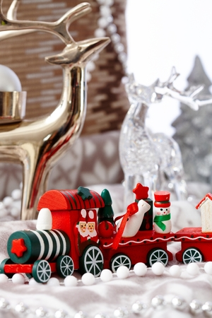 stilllife: Lovely christmas still-life with train and ornaments. Stock Photo