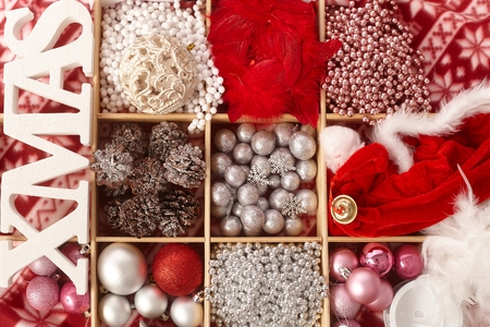 compartment: Christmas ornaments in wooden compartment with letters xmas. Stock Photo