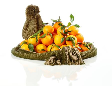 stockphoto: Pile of fresh oranges surrounded by warm scarf and hat. Stock Photo