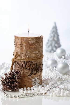 christmas candle: Natural christmas decoration with candle and pineal.